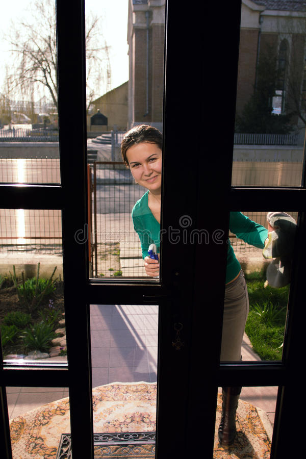 Housewife Looking Through Glass Door Stock Photo Image Of Window