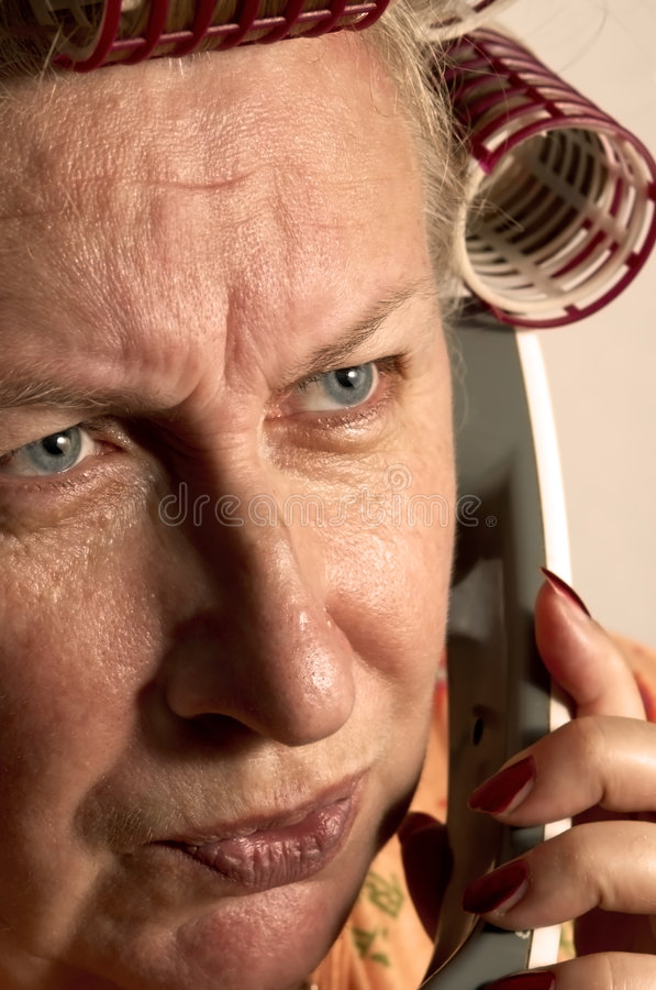 Housewife on the phone royalty free stock images