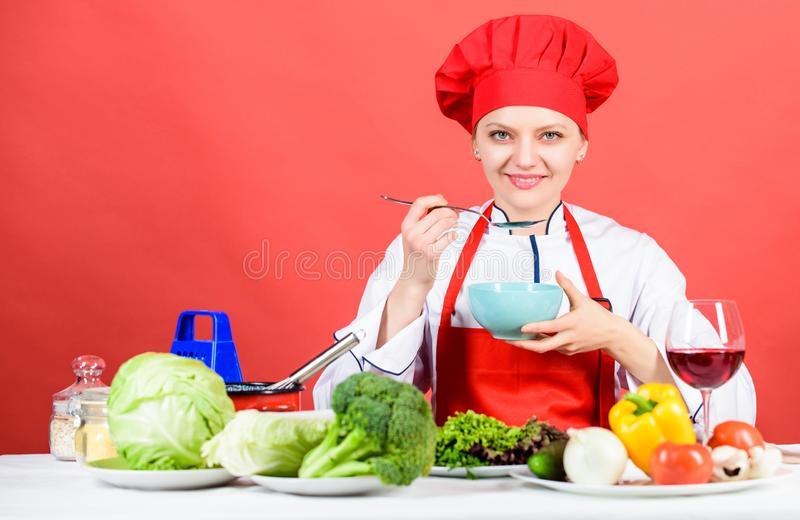Housewife routine. Cooking healthy food. Cooking meal. Professional cooking tips. Woman chef try taste eat food royalty free stock photography