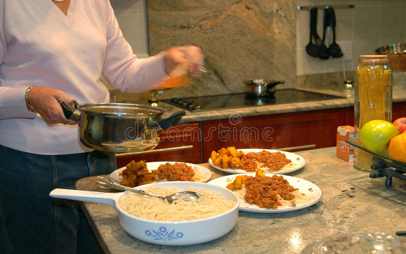 Housewife serving food stock photos