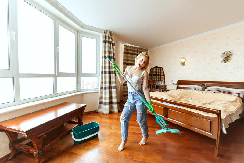 Housewife sings while cleaning. royalty free stock photo