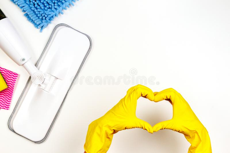 Housework, housekeeping, household, cleaning service concept. Cleaning spray mop, rags, sponges and woman hand with stock images