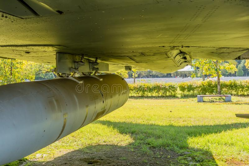 Housing for airplane machine gun. Canister housing for machine gun mounted under jet fighter on display in public park stock images