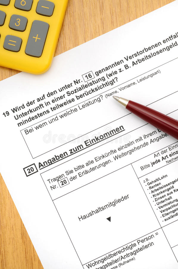 Housing allowance application. Application form for housing allowance with ballpoint-pen royalty free stock photo