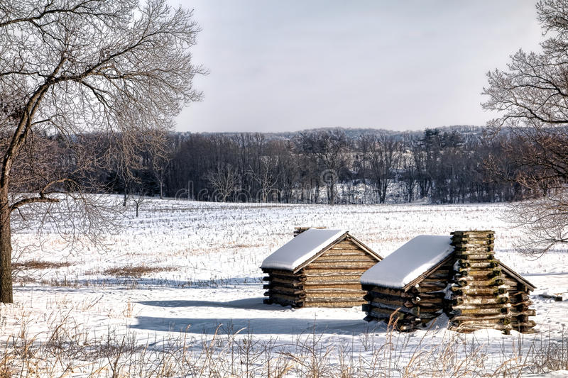 Housing Camp Cabins at Valley Forge National Park. American Revolutionary War soldier housing wood cabins landscape in an encampment in winter snow at Valley royalty free stock photography