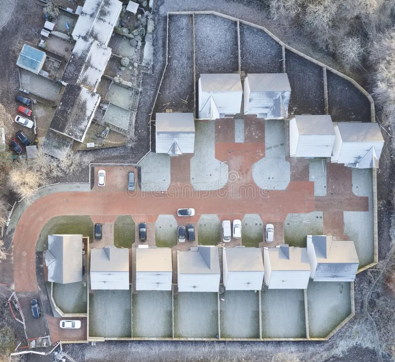 Housing development aerial view in construction on rural countryside site Scotland UK. Housing development aerial view in construction on rural countryside site stock photography