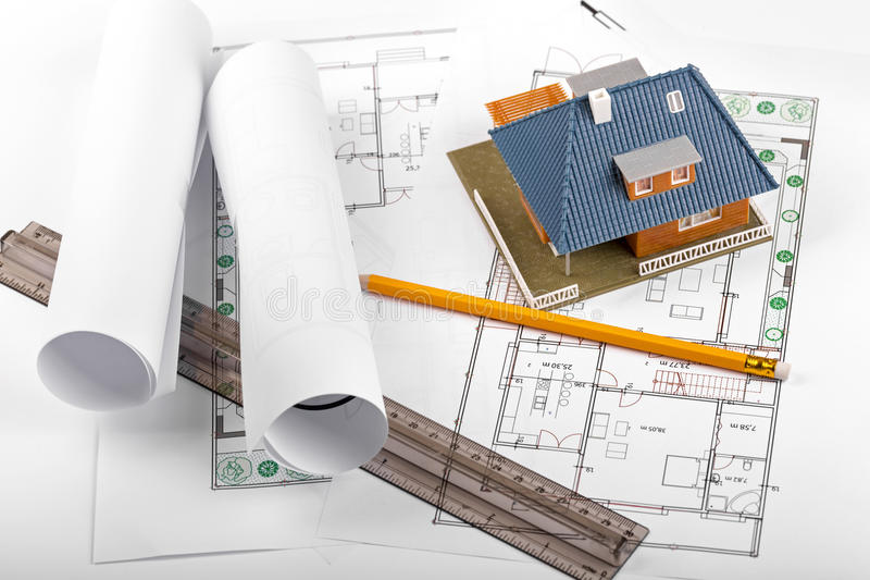 Housing development, new real estate project, house on blueprint. Housing development, new real estate project, house and tools on blueprints stock photos
