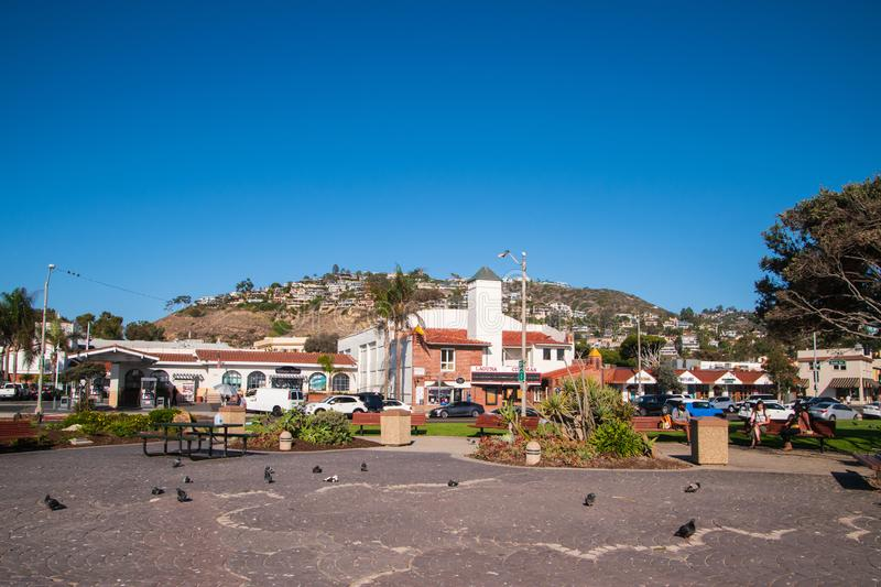 Housing development on the side of a mountain overlooking a small park. stock photography
