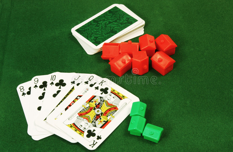 Housing Market. Playing cards with house tokens to illustrate gambling on the housing market royalty free stock photography