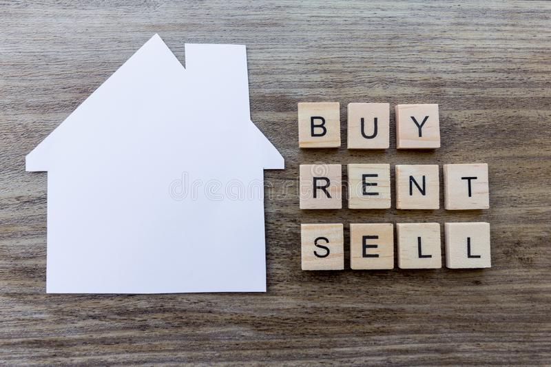 Buy, Rent, Sell - Housing Market Concept. Housing Market Concept - Paper house with the words `Buy, Rent, Sell royalty free stock photo