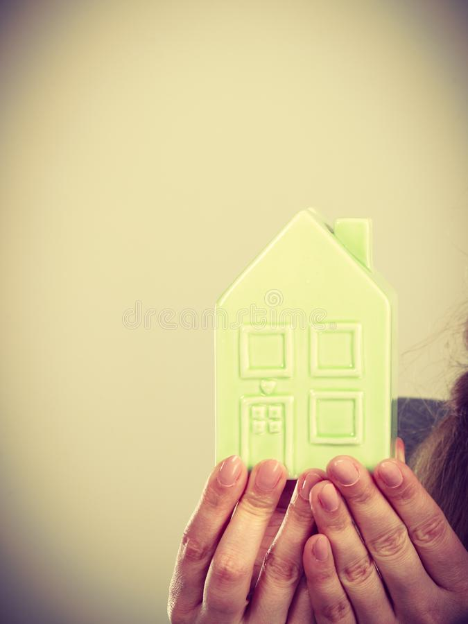 Person holding house model. Housing property ownership real estate construction finances concept. Person holding house model. Human presenting building symbol royalty free stock photo