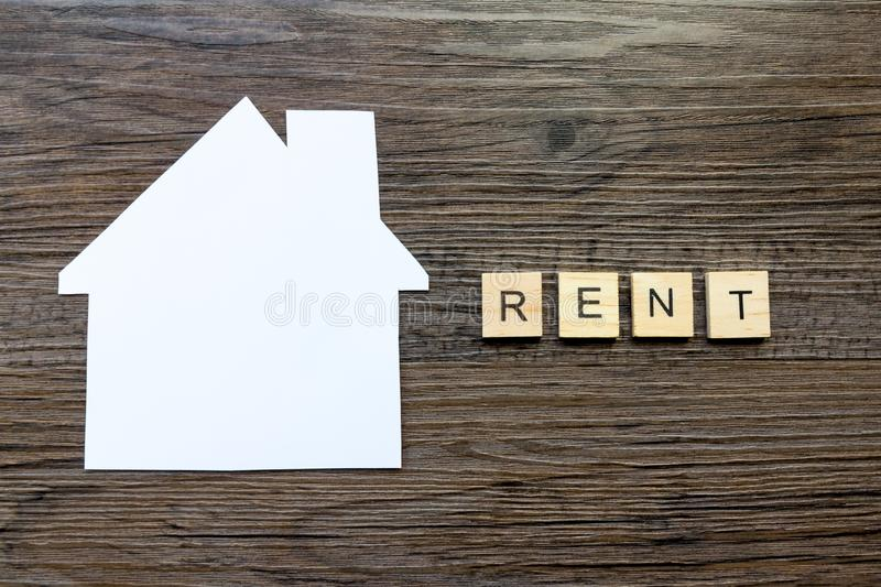Housing and Rent Concept - The word `rent` and a paper house. House Renting Concept - Paper house with the word `Rent stock images