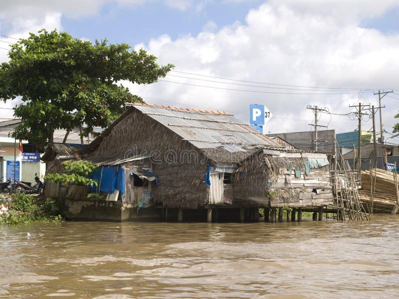 Housing Vietnamese banks of the River Mekong stock photo