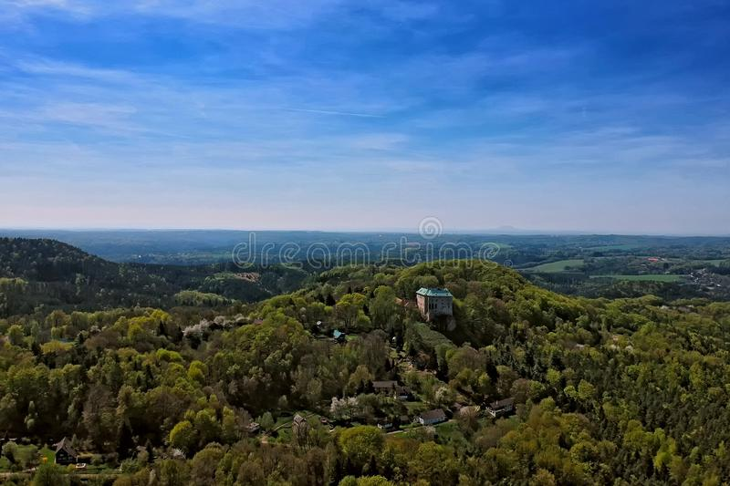 Houska castle and the surrounding countryside in the Central Bohemian region. In the Czech Republic with forest and hills - aerial photo from ultralight plane royalty free stock image