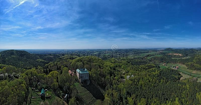 Houska castle and the surrounding countryside in the Central Bohemian region. In the Czech Republic with forest and hills - aerial photo from ultralight plane royalty free stock photo