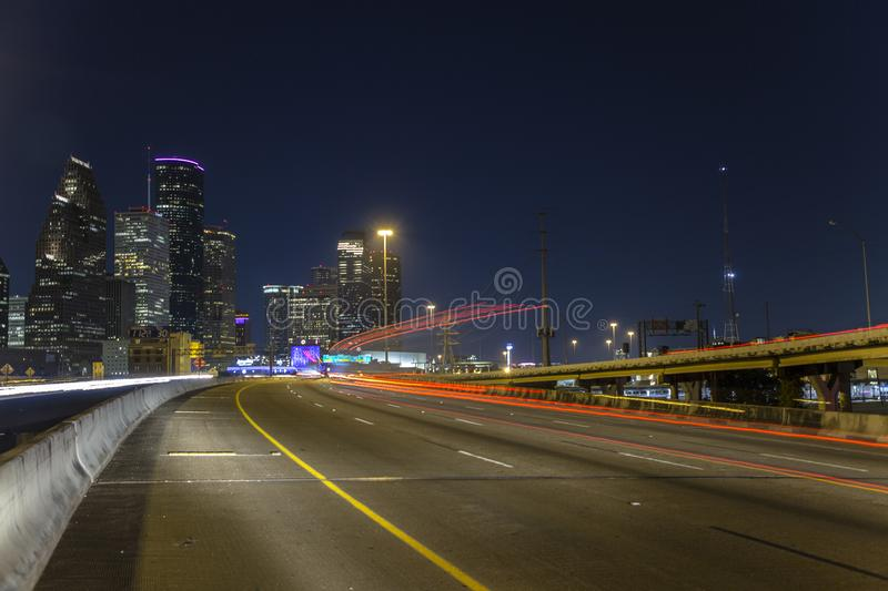 Houston downtown from freeway 10 at night stock photos