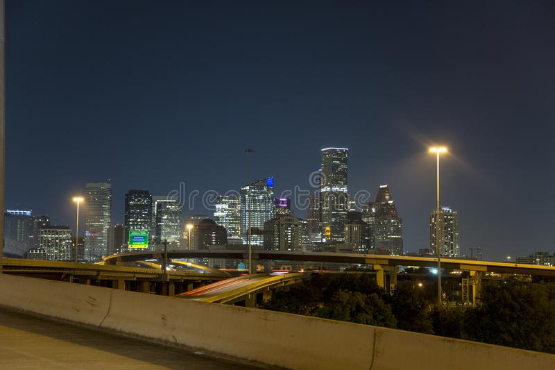 Houston downtown from freeway 10 at night stock photography