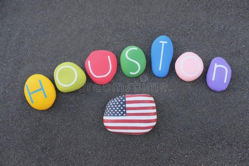 Houston, recuerdo de la ciudad principal de Texas, Estados Unidos de América, con piedras coloreadas sobre arena negra volcánica fotos de archivo libres de regalías