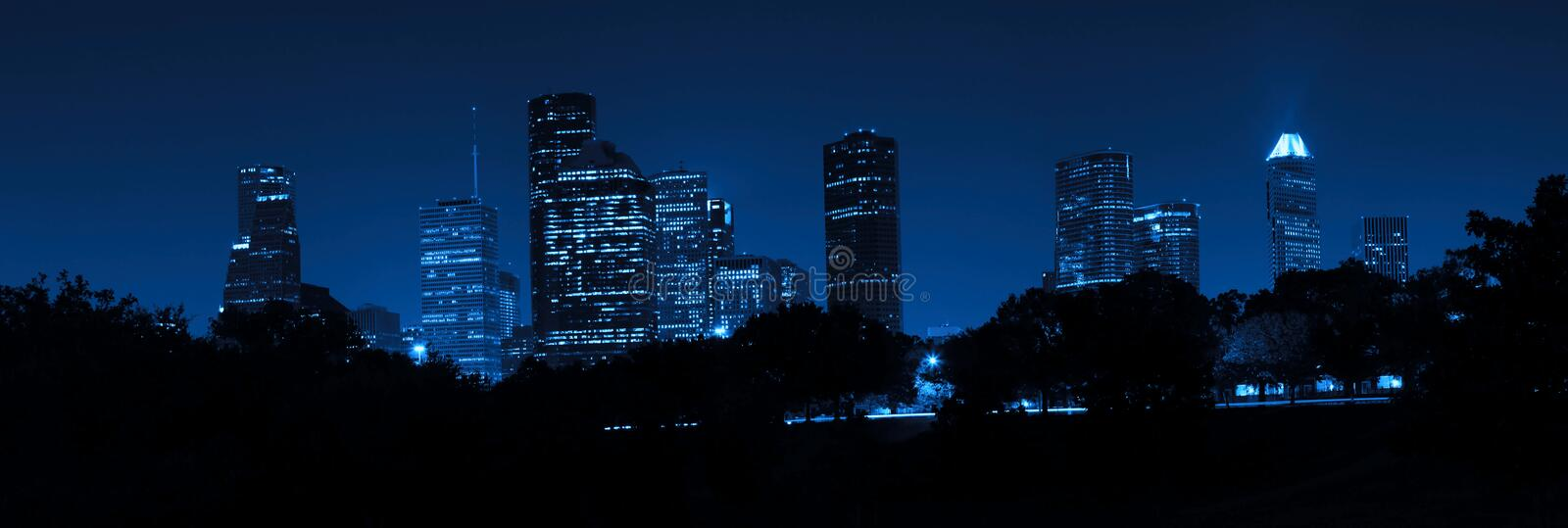Houston Skyline at Night. The Houston Skyline at Night in Blue with Allen Parkway in the foreground stock photos