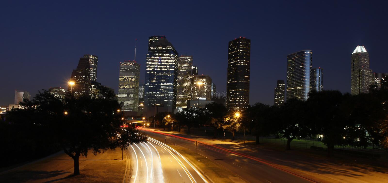 Houston Skyline at Night. The Houston Skyline at Night with Allen Parkway in the foreground stock photos