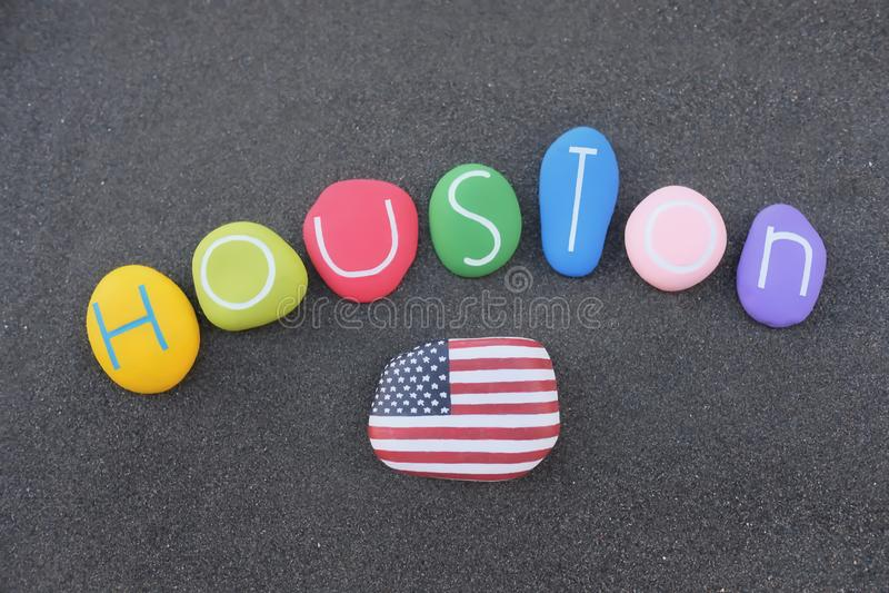 Houston, Souvenir of the main city of Texas, Vereinigte Staaten von Amerika mit farbigen Steinen über schwarzem vulkanischen Sand lizenzfreie stockfotos