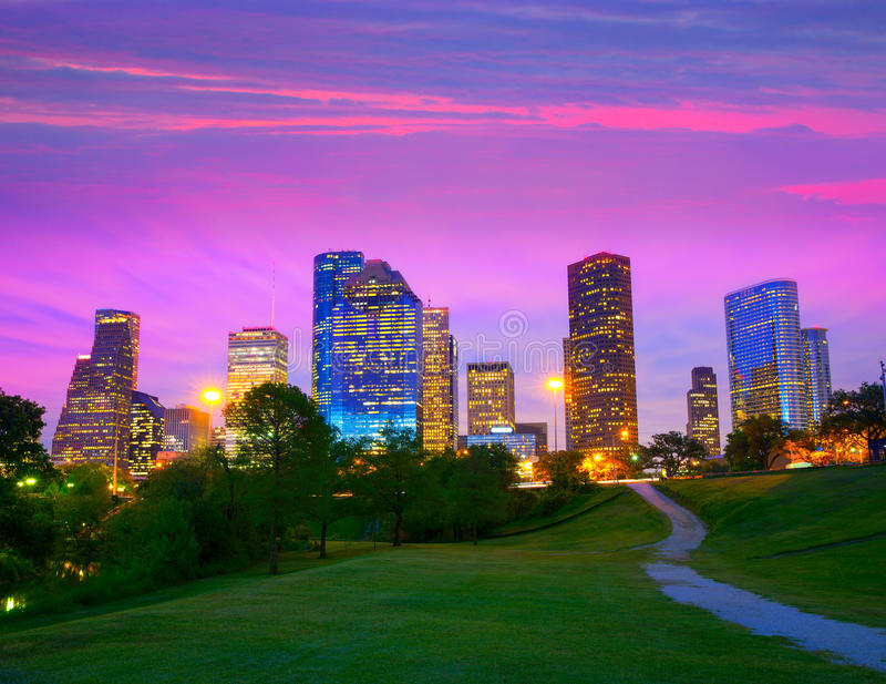Houston Texas modern skyline at sunset twilight from park. Lawn royalty free stock photography