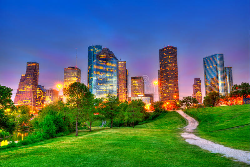 Houston Texas modern skyline at sunset twilight on park. Houston Texas modern skyline at sunset twilight from park lawn HDRI stock photography