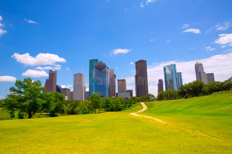 Houston Texas Skyline modern skyscapers and blue sky. Houston Texas Skyline with modern skyscapers and blue sky view from park lawn stock photo