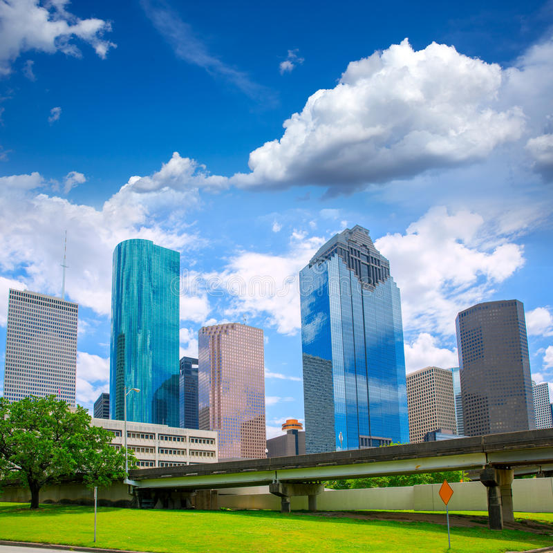 Houston Texas Skyline modern skyscapers and blue sky. Houston Texas Skyline with modern skyscapers and blue sky view from park lawn stock image