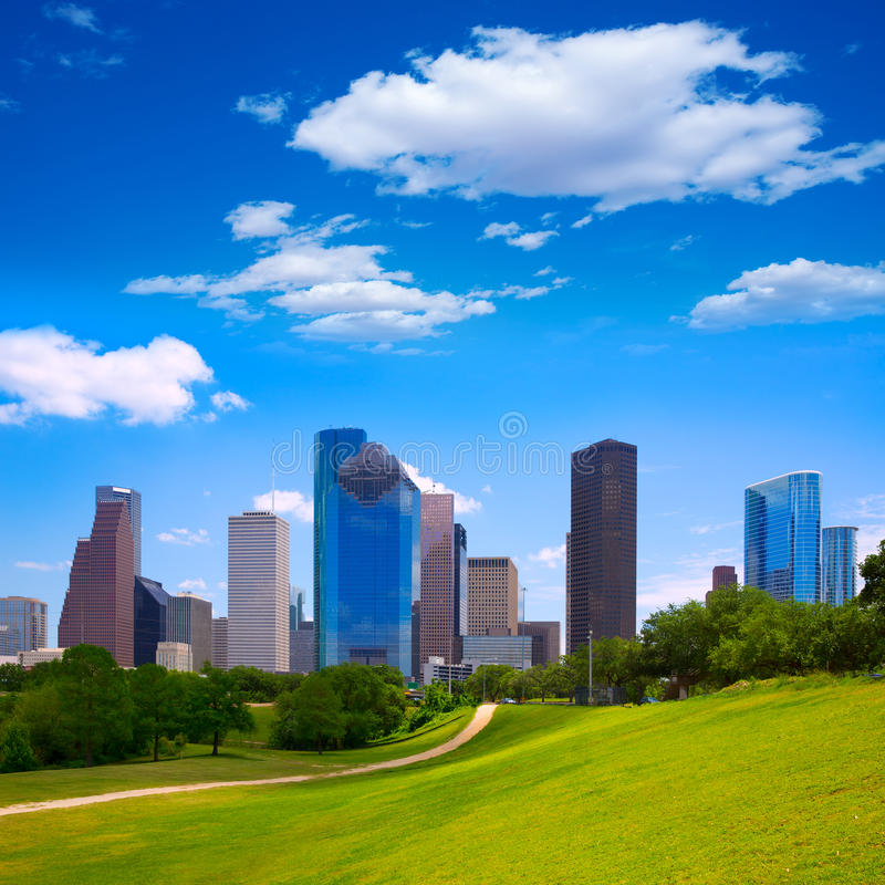 Houston Texas Skyline modern skyscapers and blue sky. Houston Texas Skyline with modern skyscapers and blue sky view from park lawn royalty free stock images