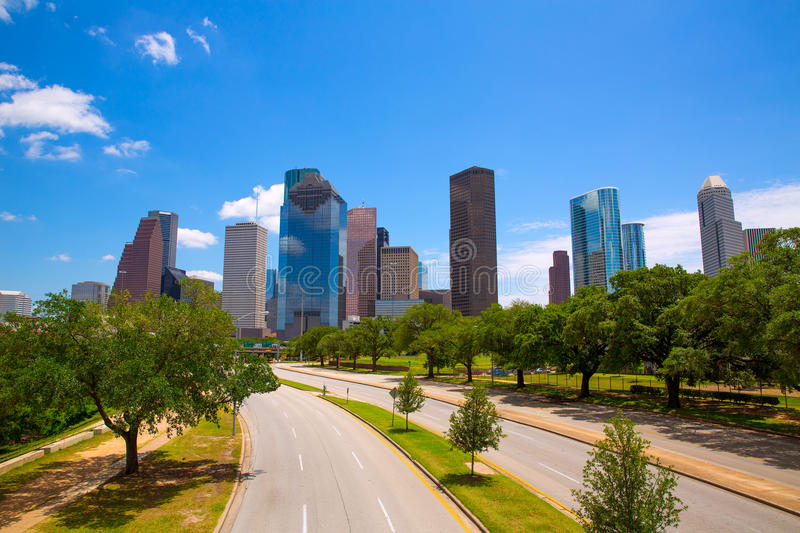 Houston Texas Skyline with modern skyscapers. And blue sky view from road stock images