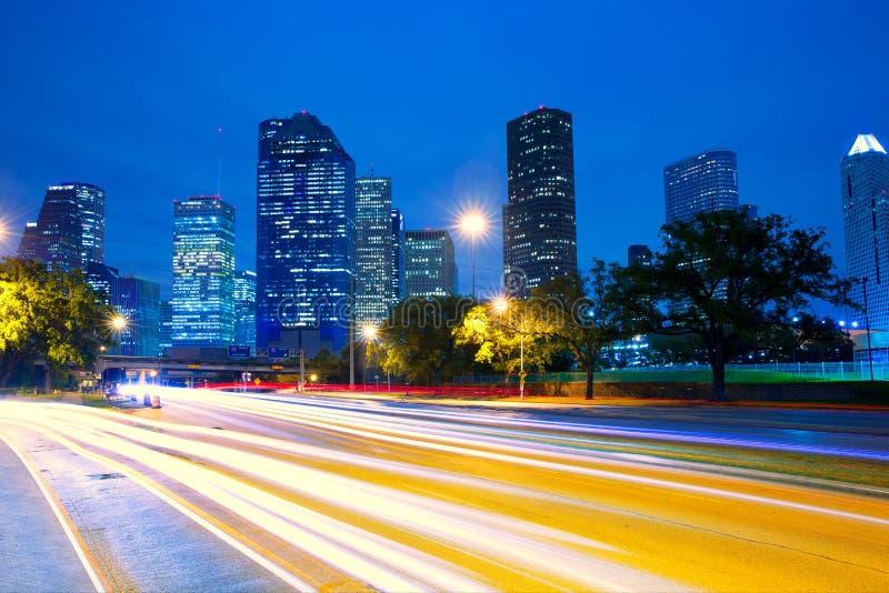 Houston Texas skyline at sunset with traffic lights. Houston Texas modern skyline at sunset twilight with traffic headlights lights trace royalty free stock photos