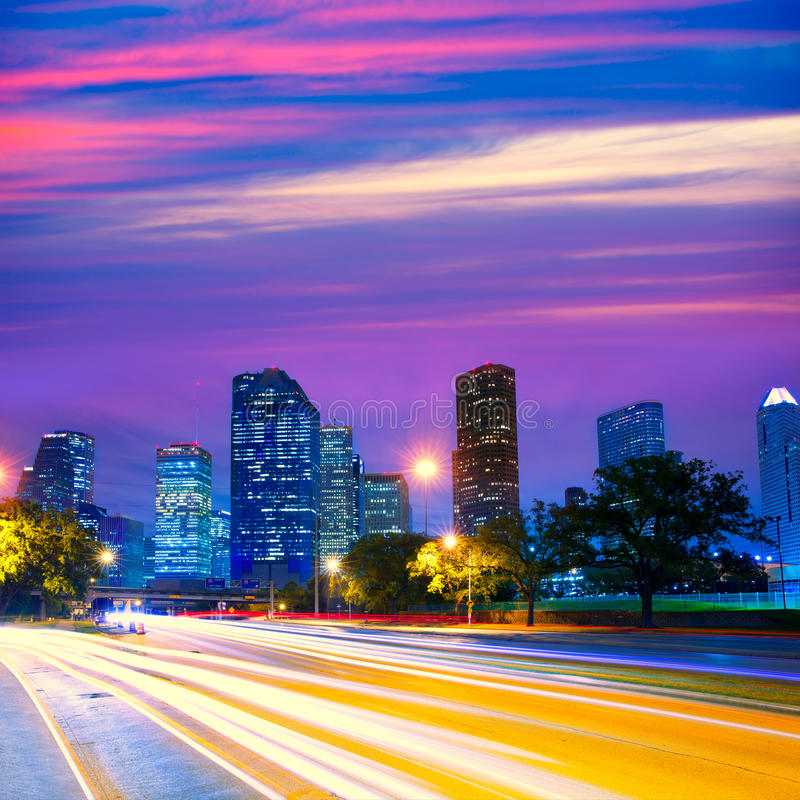 Houston Texas skyline at sunset with traffic lights. Houston Texas modern skyline at sunset twilight with traffic headlights lights trace royalty free stock photography