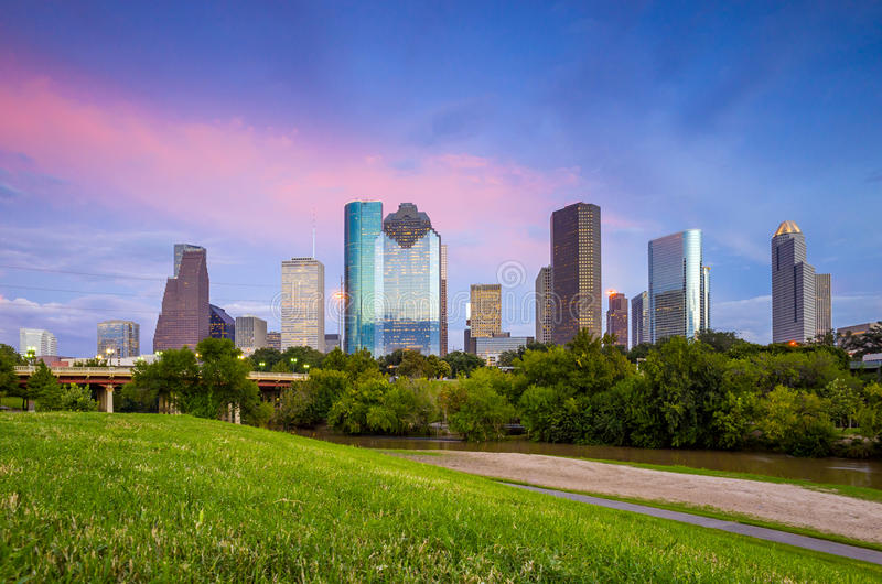 Houston Texas skyline at sunset twilight from park lawn. Houston, Texas skyline at sunset twilight from park lawn royalty free stock photo