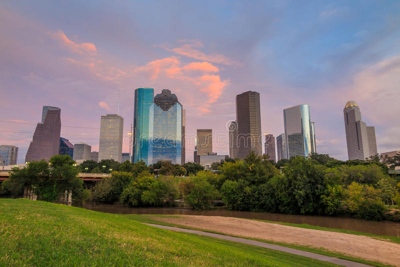 Houston Texas skyline at sunset twilight from park lawn. Houston, Texas skyline at sunset twilight from park lawn stock photo