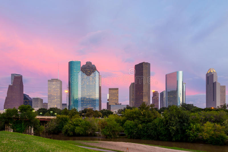 Houston Texas skyline at sunset twilight from park lawn. Houston, Texas skyline at sunset twilight from park lawn royalty free stock images
