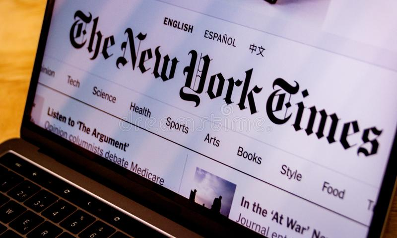 The New York Times landing page on laptop screen stock photos