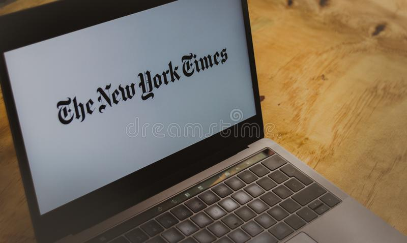 The New York Times logo on laptop screen stock photography