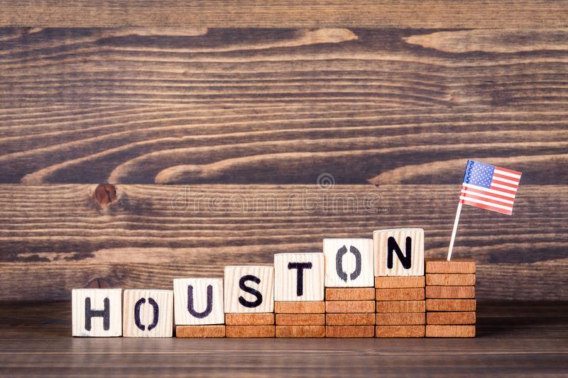 Houston United States. Politics, economic and immigration concept. Wooden letters and flag on the office desk royalty free stock photo