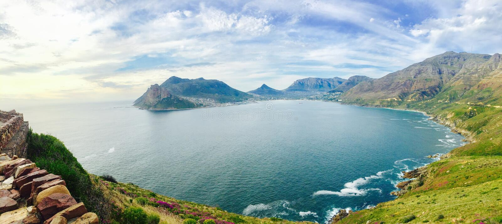 Hout Bay in Cape Town, South Africa. Hout Bay of Atlantic Ocean with its silky and calm surface at sunset in early summer, in Cape Town, South Africa royalty free stock photo