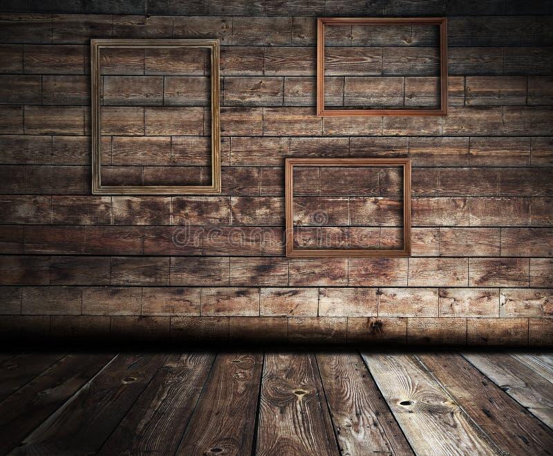 Houten binnenland met frames stock afbeelding