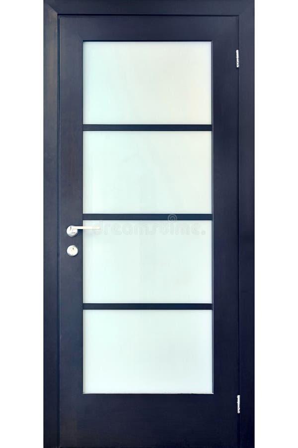 Houten binnenlandse zwarte deur van ebbehout met zilveren metaalhandvat en stock foto