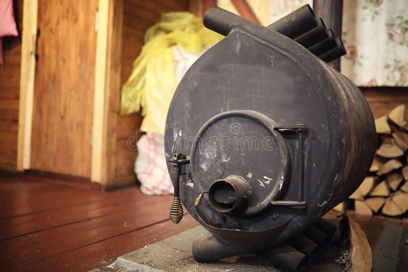 Houten Brandend Fornuis Brandhout voor oven het verwarmen Pakhuis voor stock fotografie