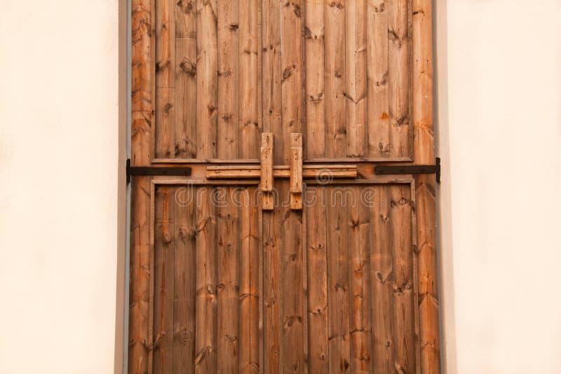 Houten deurklink stock afbeelding