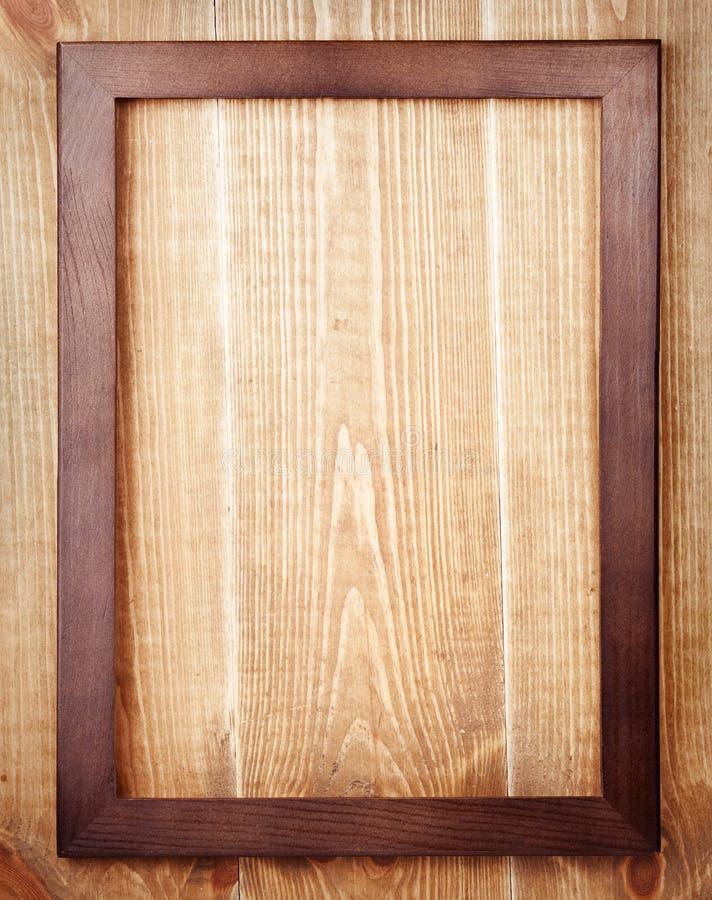 Houten kader op houten achtergrond stock afbeeldingen