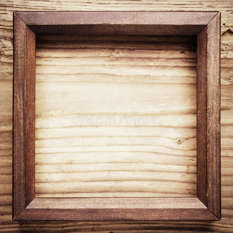 Houten kader op houten achtergrond stock foto