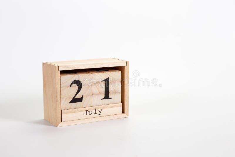Houten kalender 21 Juli op een witte achtergrond royalty-vrije stock afbeelding