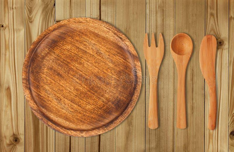 Houten Keukengerei over houten achtergrond stock foto's