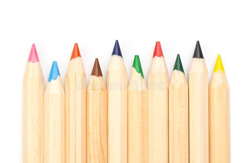 Houten kleurrijke gewone die potloden op een witte achtergrond, Beeld worden geïsoleerd stock fotografie