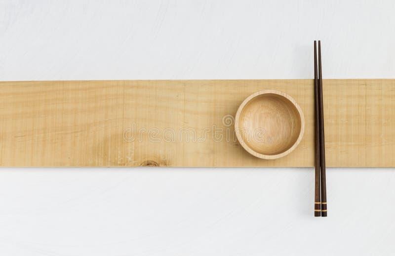 Houten kom en houten eetstokje stock fotografie